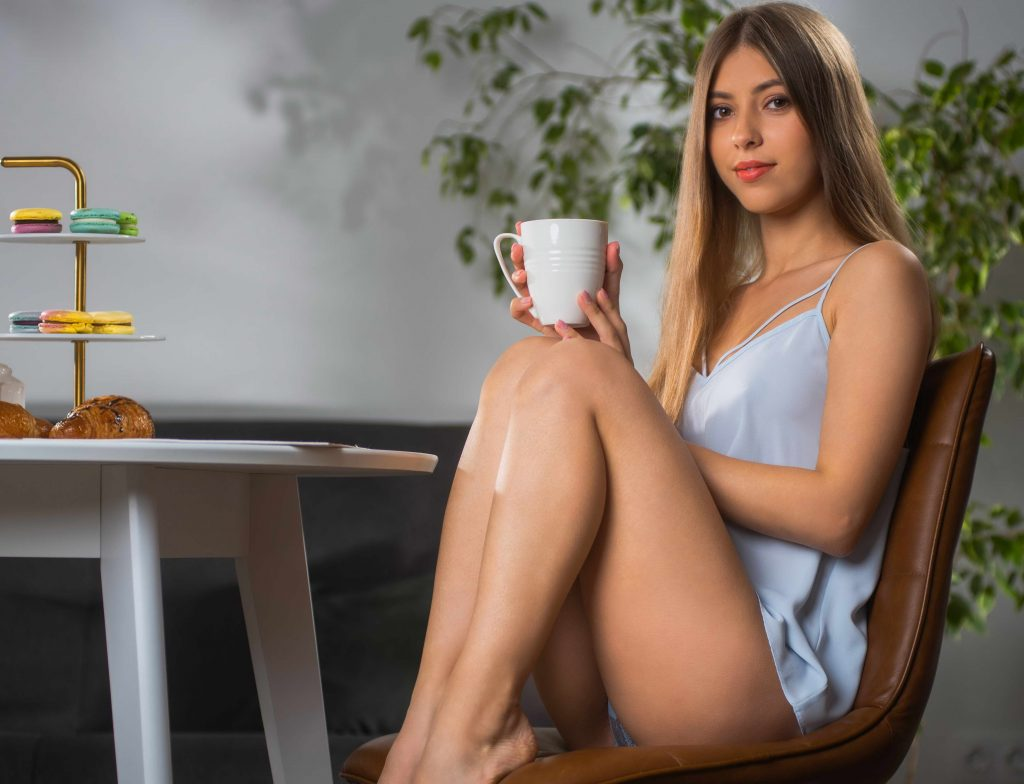 cheap escorts - sexy girl with coffee cup